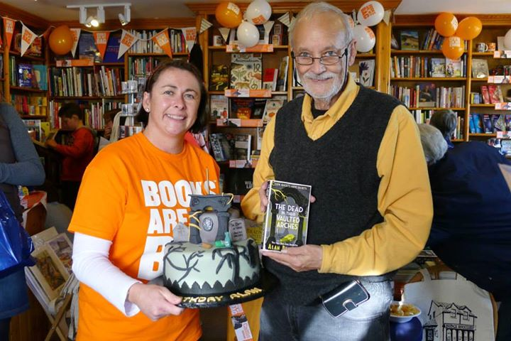 Alan Bradley with his book and matching birthday cake.jpg